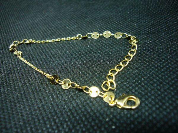 Fin bracelet en plaqué or 3 microns, dim. 15,50 cm + 3cm d'extension.
