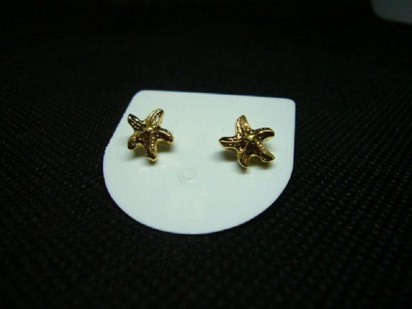 Boucles d'oreilles bouton étoile de mer plaqué or.